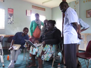 Staff from the Mayuge district education department are taken through an demonstration on the use of blogs